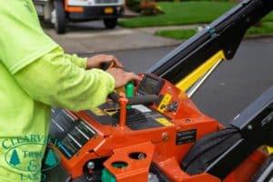 tree worker operating equipment